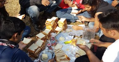 Bikers Preparing Sandwiches at Satara Windmills