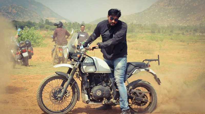Riding a bike Royal Enfield Himalayan Vinod Basavaraju